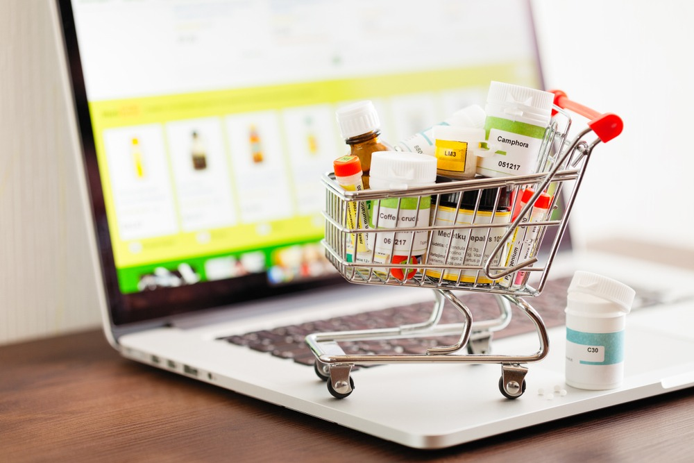 An image of medicines in a trolley on a laptop, Cyber Hero provides information of buying medicines online.