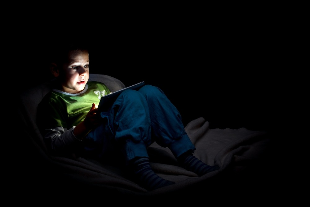 An image of a boy online at night, we deliver information about suicidal ideation.