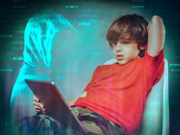 An image of a boy online, Cyber Hero provides phishing definitions and advice.